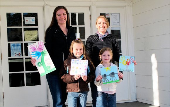 """""""Team J Moms"""" Jenelle Walker & daughter Jessa (l), & Jasmine Borgatti & daughter Madison (r), show some of the artwork used to create tiles for the Mt. Shasta Elementary Student Art Tile Wall Project."""