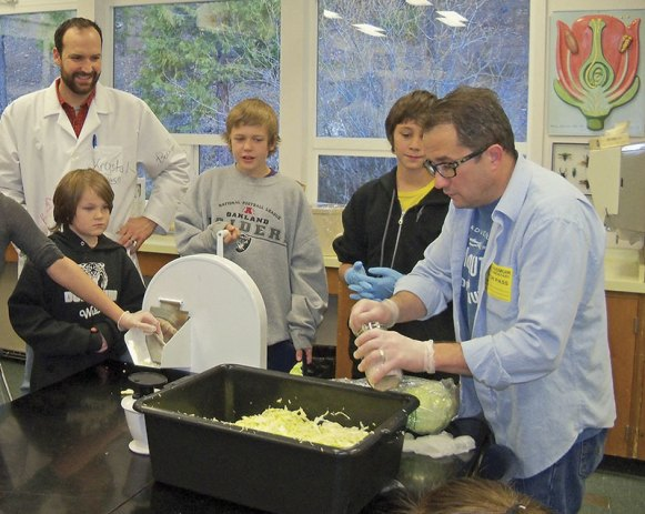 Dunsmuir Elementary School science teacher Spencer Adkisson and some of his students prepare to get hands-on with their sauerkraut-making project led by David Edmondson of Salt and Savour.