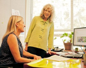 Sheila McQuaid (left) and Cindy Wolff(right) make plans for offering community classes including working with local farmers.