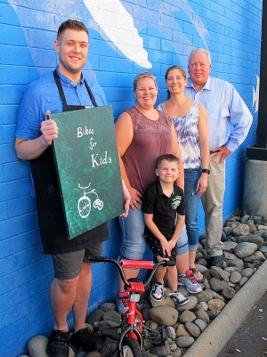 Left to Right: Casey Ripley from Starbucks, Jessie Cork and Bristol Nash from Youth & Family Programs, Ted Blankenheim, and young Jaxsyn Tyson. All enjoy community activism and sharing their enthusiasm for children receiving holiday bikes.