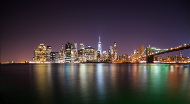 New York City skyline at night photo by Ian Norman