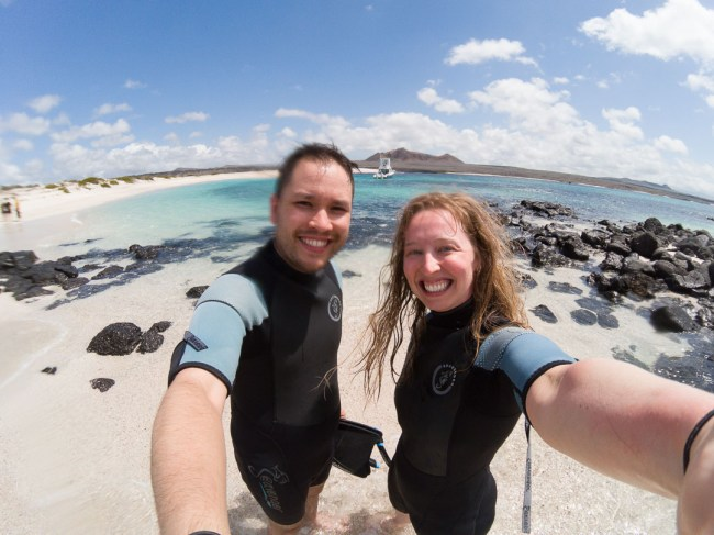 Our smiles, just after snorkeling at Bahía Rosa Blanca on San Cristobal Island.