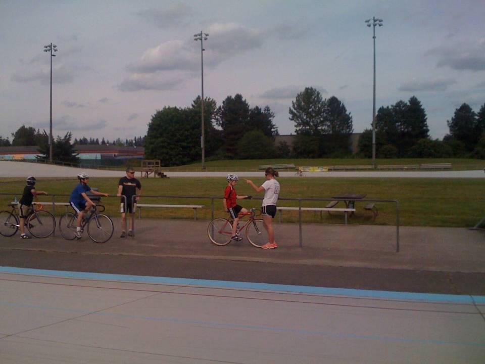 A younger Sam gets some wisdom from Tela Crane at the Velodrome.
