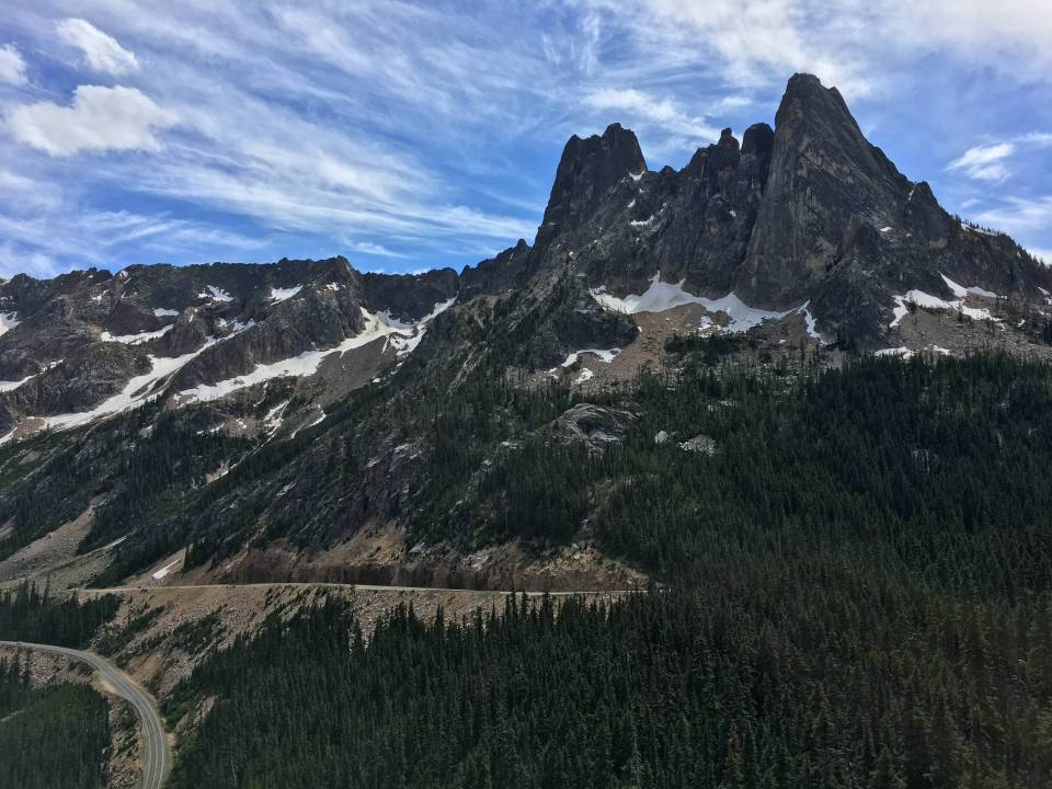 The Early Winter Spires and Liberty Bell from the Washington Pass Overlook. The Beckey Route on the southwest side of Liberty Bell (rightmost spire) is probably the most famous alpine rock climb in the North Cascades.