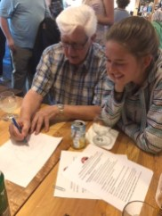 Claus Windelev drawing a map of Denmark for his granddaughter, Sofia. Photo by Karen Eisenhut
