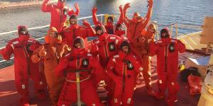 Purpose is to illustrate the use of survival suits when abandoning ship