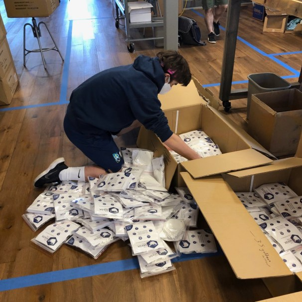 Rowen Norfolk '22 prepares a shipment of masks. (Photo: provided)