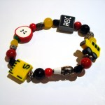 bracelet for teachers with images of apple, school bus, ruler and chalkboard by Karen Roodman