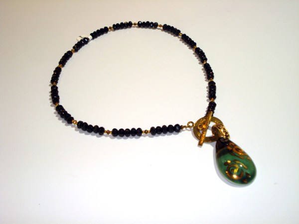 black bead necklace with large jade pendant