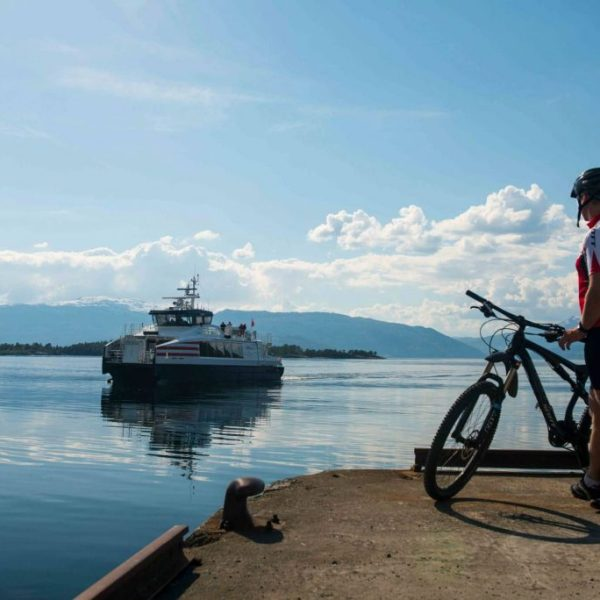 Bike rider awaiting ferry transfer in Hardanger