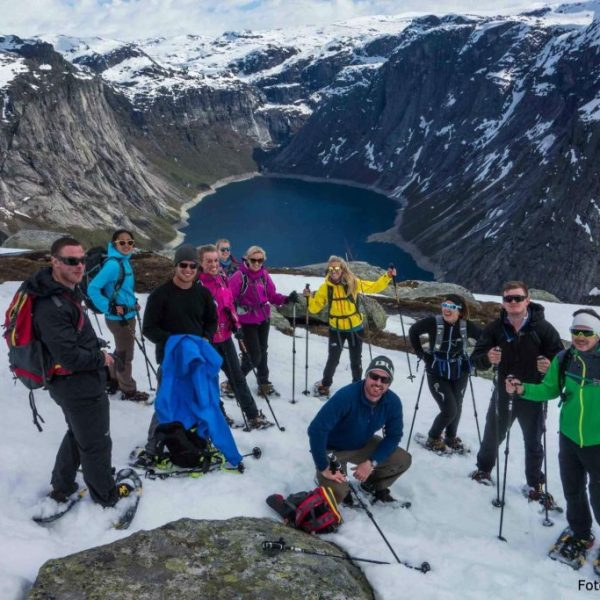 Group on top of Trolltunga on snowshoes