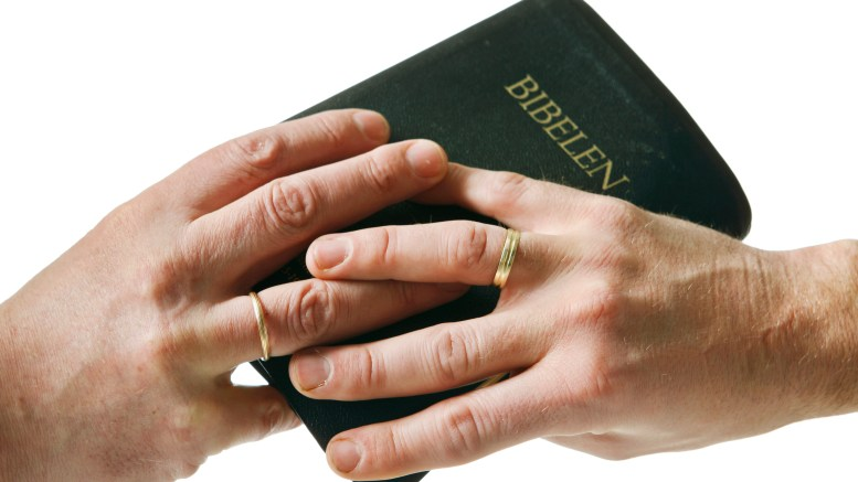 Gay couples with Bible
