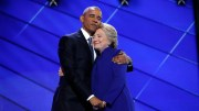 Democratic presidential nominee Hillary Clinton hugs U.S. President Barack Obama