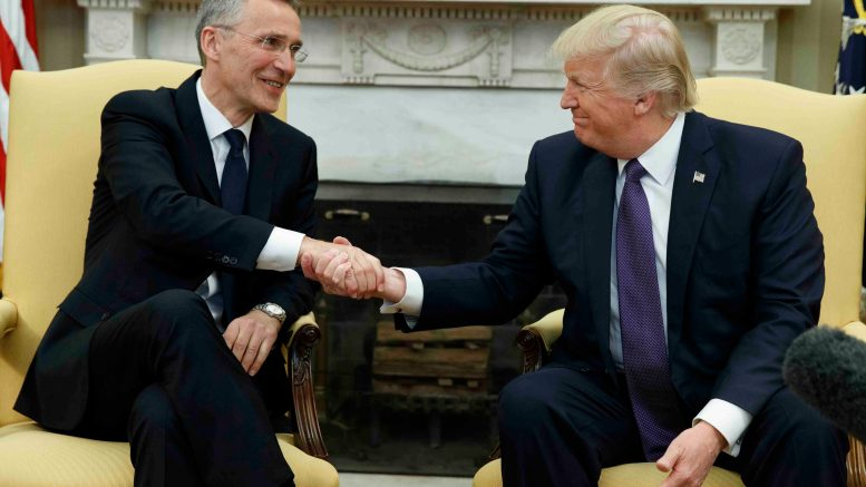 President Donald Trump shakes hands with NATO Secretary General Jens Stoltenberg