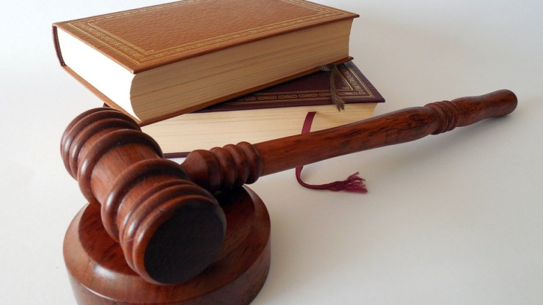 Law book gavel 16-years-old girl
