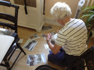Nancy Osgood sorting photos