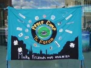 Peace-Camp-banner-in-front-of-Forum-300x224
