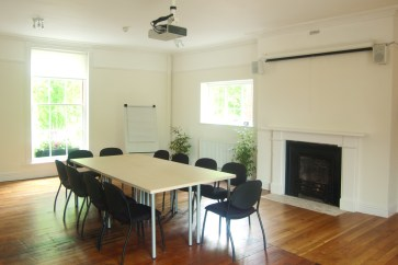 The beautiful Gallery room is full of light from windows on three sides and has plenty of space for meetings.