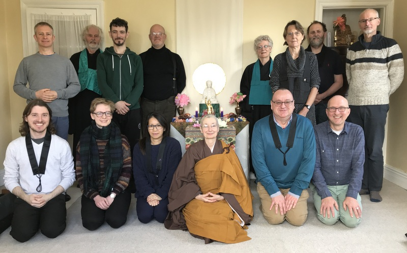 Rev. Leoma and the Sangha around the altar after a festival ceremony