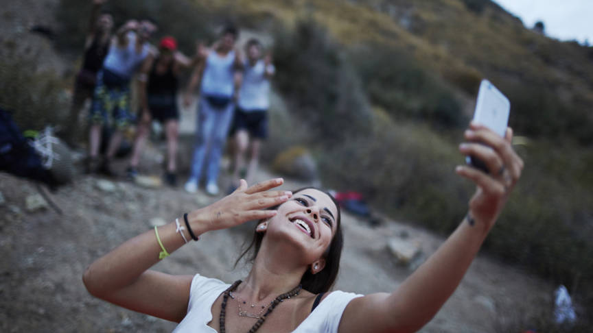 Syrian woman refugee makes selfie on Lesbos