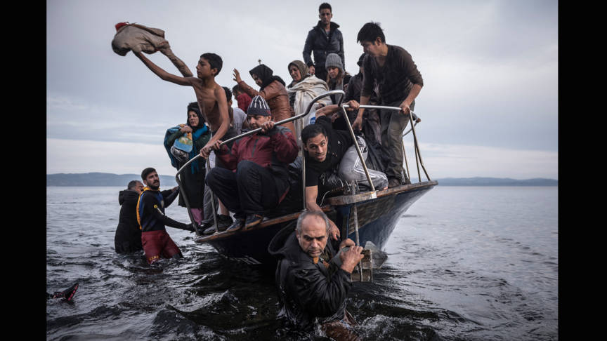 Refugees arrive on Lesbos, photo by Sergey Ponomarev