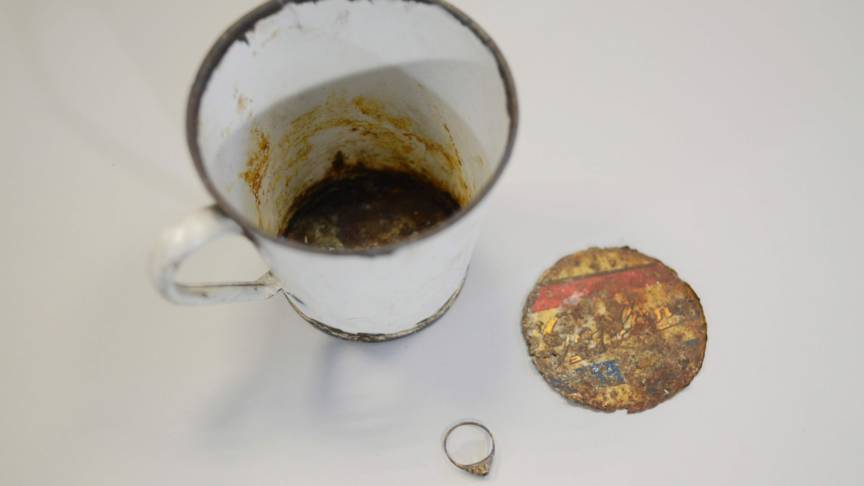Auschwitz coffee mug and hidden jewelry, AFP photo