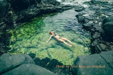 Woman floating in secret cove