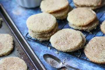 low carb keto snickerdoodle cookies cooling on a baking tray and rack