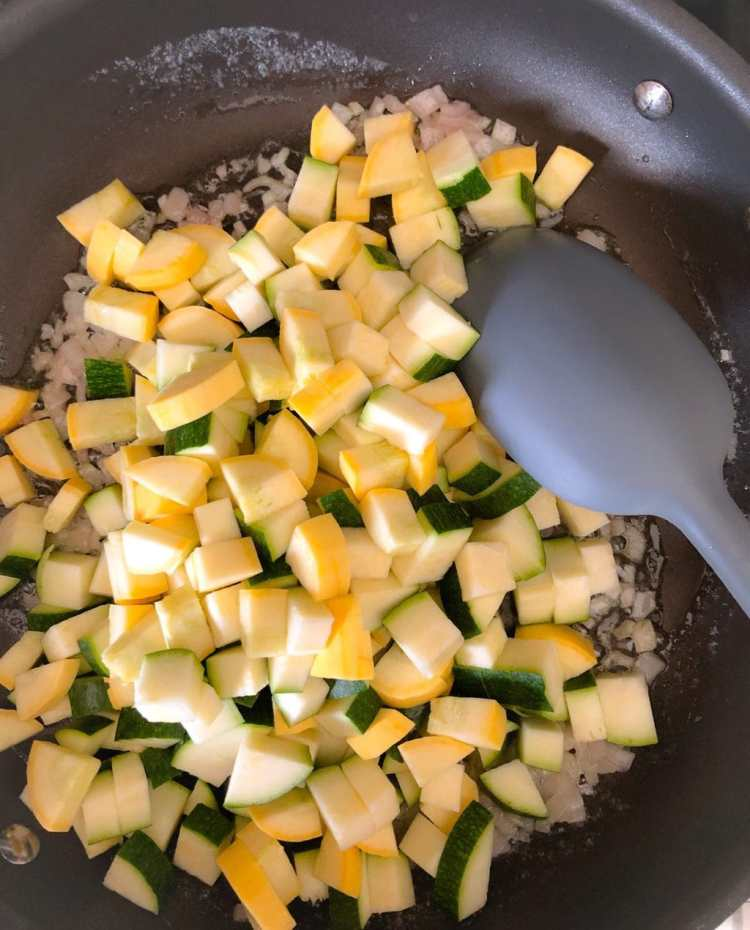 diced zucchini and yellow squash in a saute pan