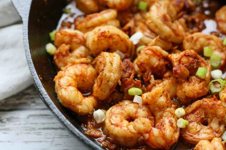 Cooked low carb cajun shrimp with green onions