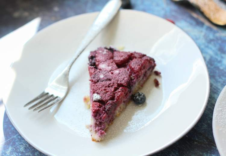 slice of low carb berry skillet cake on a white plate