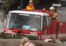 Fire Truck coming out of an extremely deep water fording run
