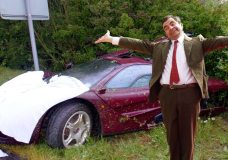 Mr. Bean in front of his Mclaren F1 after a bad accident