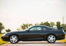 Uber low mile Toyota Supra drivers side view