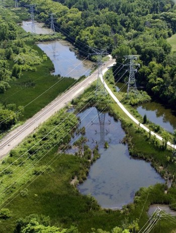 Swampy areas near overhead power lines northwest of Chicago are visible in areas designated for spraying
