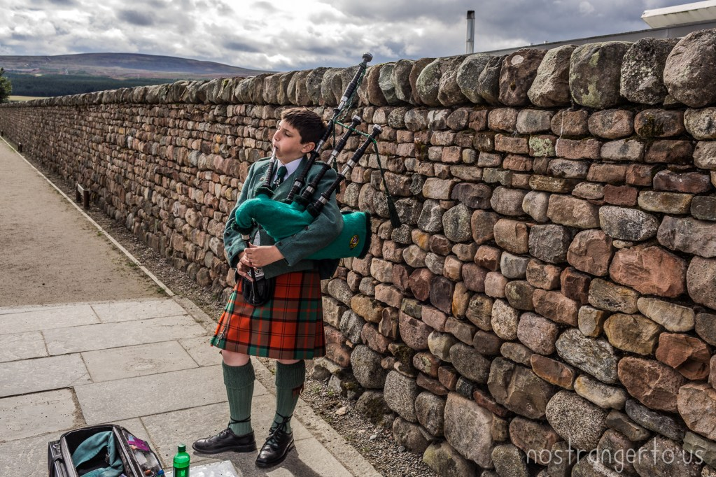 This kid desperately needed to get bag pipe lessons and tune his pipes so we tossed him a few quid.