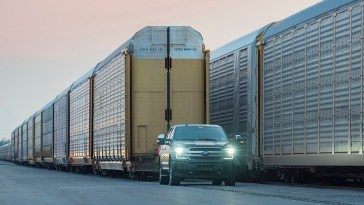 ford electric truck pulling rail carriages