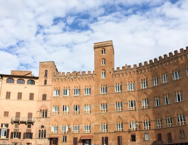 Palazzos line the Piazza del Campo in Siena, Italy