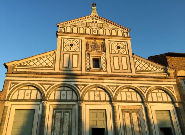 The Basilica di San Miniato al Monte is a great place to catch sunset in Florence, Italy