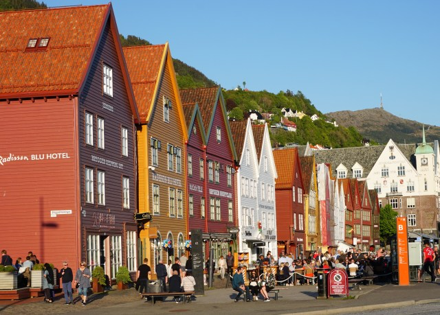 Bryggen bustles with activity on a sunny afternoon in Bergen, Norway