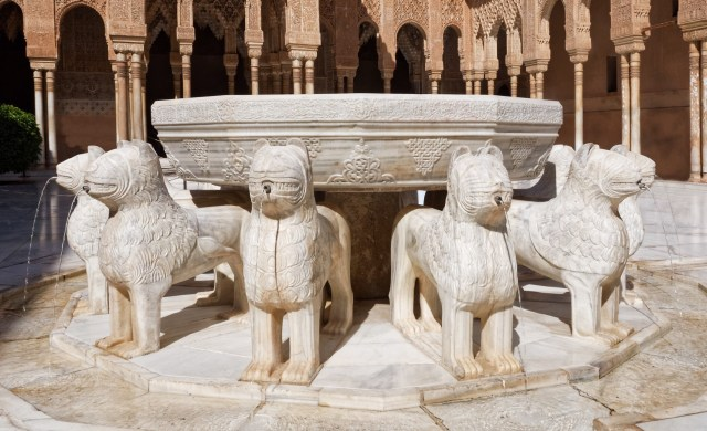 The Fountain of the Lions in the Nasrid Palaces Alhambra Granada Spain