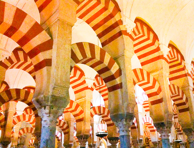 The candy cane arches of the Mezquita in Cordoba, Spain: Cordoba is one of the best day trips from Seville you can do.