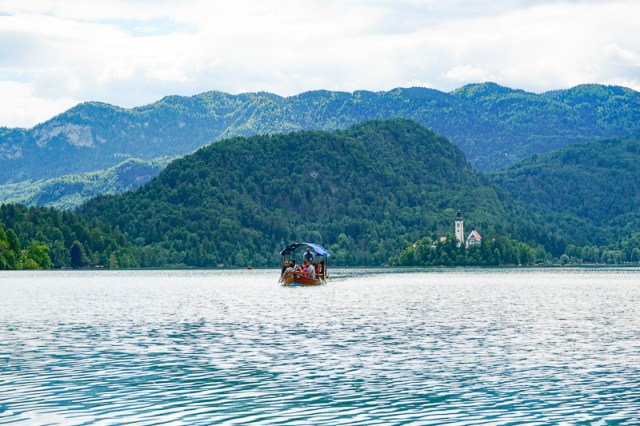 A pletna boat carrying visitors to Bled Island in lake Bled, Slovenia