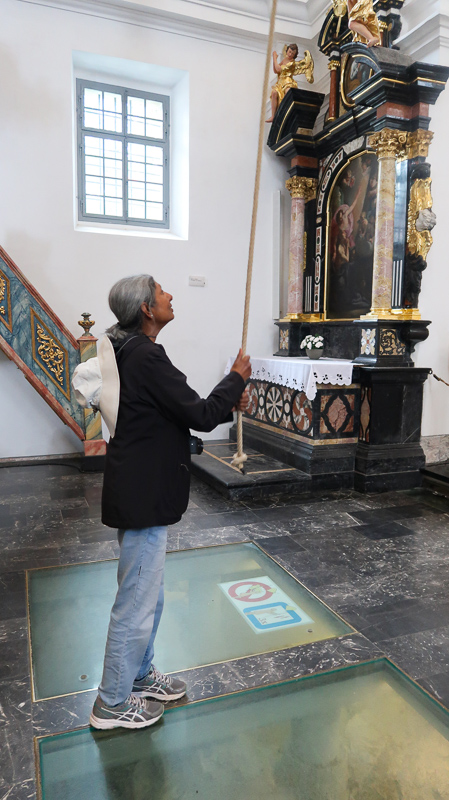 Ringing the bell at the church on Bled Island