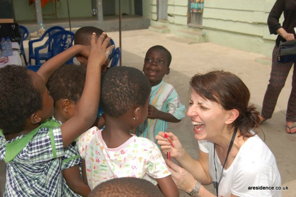 Davina McCall with children in Ghana for Comic Relief