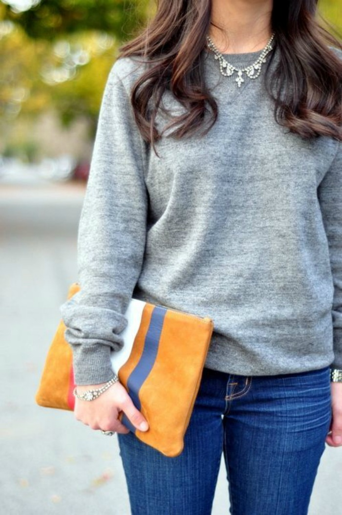 great sweatshirt, orange clutch