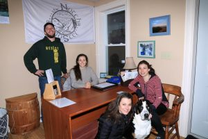 Staff at The Notch Hostel. From left to right, Justin Walsh (owner), Stephanie Robinson (staff) Serena Walsh (owner) and Delilah (mascot), Shannon Grossman (staff).