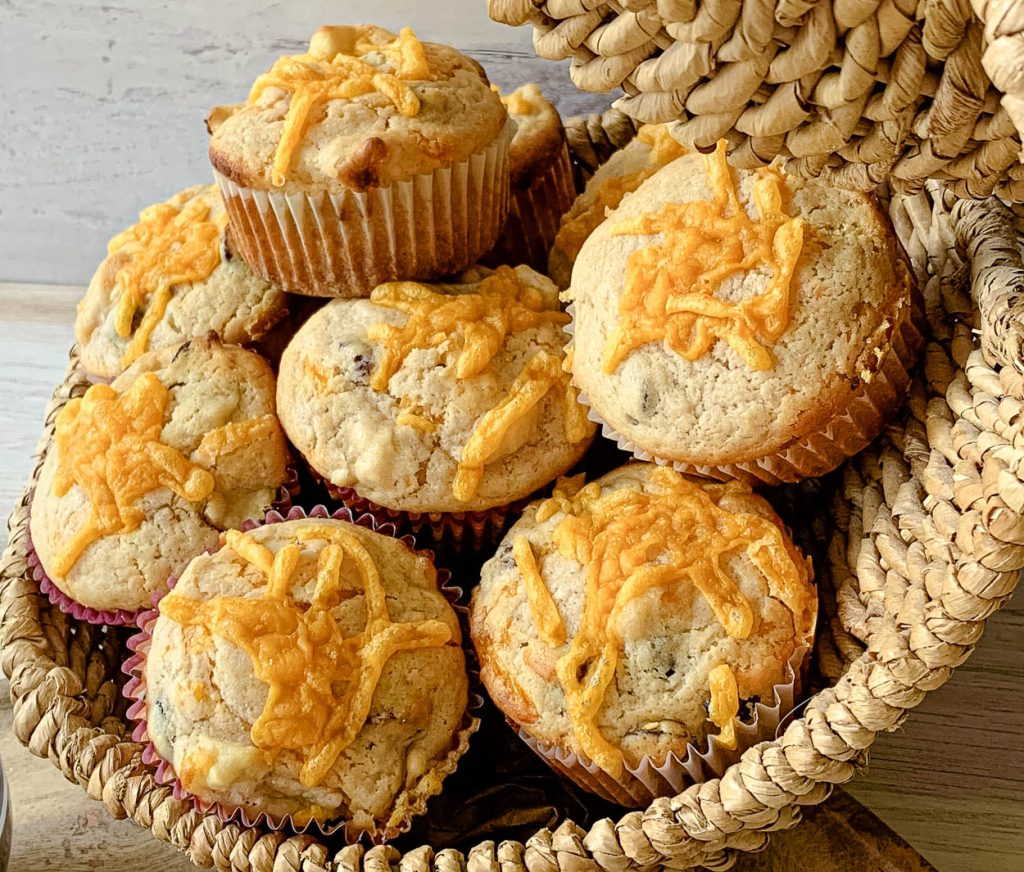 basket of apple cranberry & cheddar muffins
