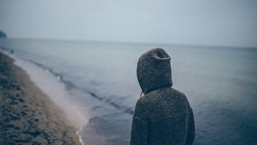 beach in hoodie