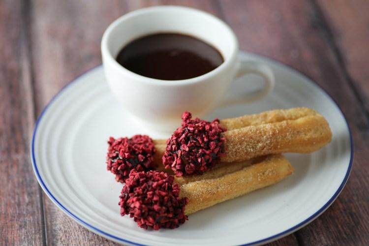 baked churros and rasberries